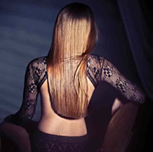 A woman facing back with brown straightened hir