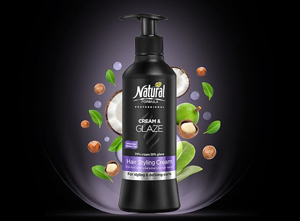 A bottle of Hair Styling Cream - Cream & Glaze. In the background images of coconut and leaves