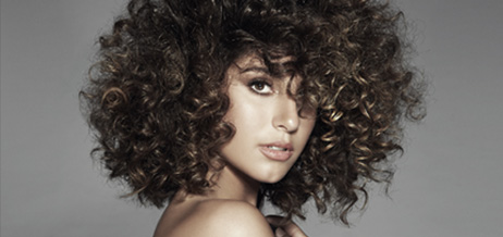 A woman with short brown curls