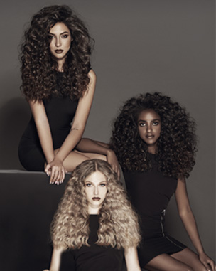 Three women with curly hair . The women's hair colors are brown, black and blonde