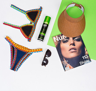 Swimsuit, a bottle of Natural Formula, sunglasses, hat and magazine
