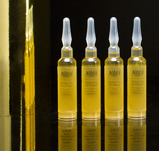 Four standing ampoules of Keratin Intense