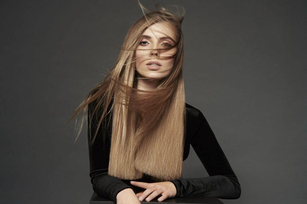 Woman with long blond straight hair.